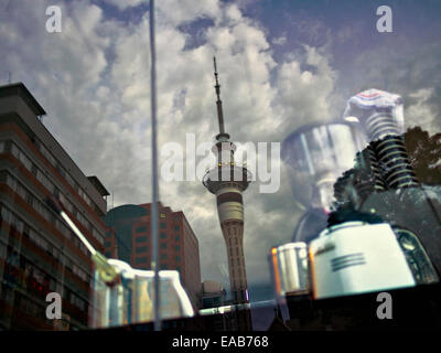 Auckland Skytower reflected in cafe window. - Stock Image