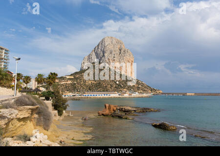 Calp Spain Penon de Ifach rock tourist attraction Spanish Mediterranean coast blue sea and sky - Stock Image