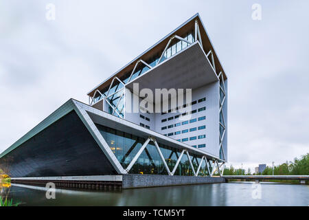 Modern looking office building design near water - Stock Image