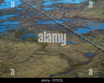 Aerial view of the Badami pipeline carrying crude oil from the Alaska North Slope fields through the tundra somewhere - Stock Image
