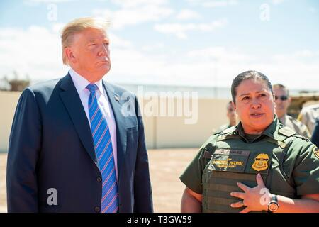 U.S President Donald Trump listens to CBP Agent Gloria Chavez, right, during a visit to the Border Patrol Calexico Station April 5, 2019 in Calexico, California. Trump visited the section of wall at Calexico that was part of a replacement project started under President Obama. - Stock Image