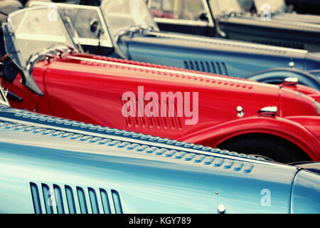 Row of red and blue classic cars - Stock Image