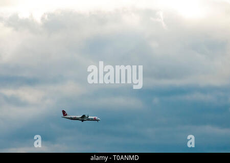commercial airplane CSA, Czech national airline,  landing over a cloudy sky - Stock Image