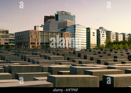 Berlin center holocaust memorial people beton stelen architect Peter Eisenmann background Sony Center - Stock Image