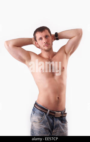The young man in the studio shirtless - Stock Image