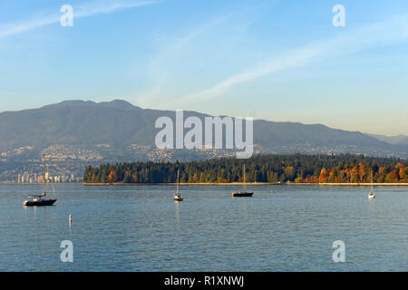 English Bay with Stanley Park,city of West Vancouver, and the North Shore Mountains in background, Vancouver, BC, Canada - Stock Image