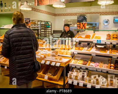 Women shopping at a Marks and Spencer Simply Food supermarket Bakery - Stock Image
