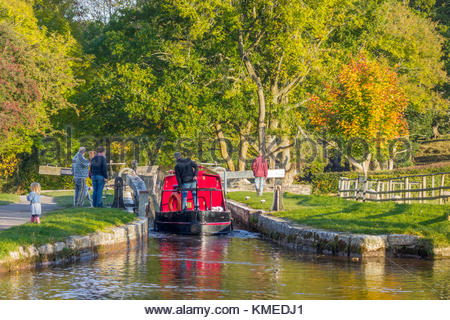 A narrowboat entering Llangynidr Lock No.64 on the Monmouthshire & Brecon Canal, Llangynidr, Powys, Wales, UK - Stock Image