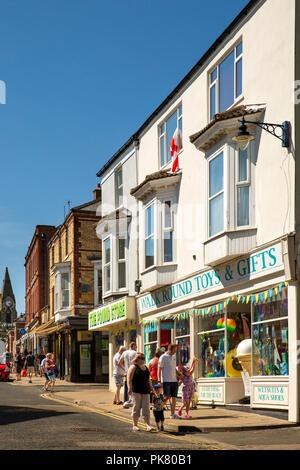 UK, England, Yorkshire, Filey, Murray Street, visitors looking at shops - Stock Image
