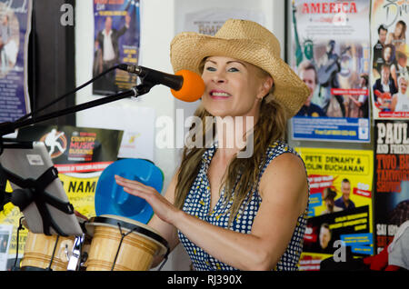 Lindi Jane, half of 'Dave Drummond and Some Blonde Chick' busking at Tamworth Country Music Festival 2019. - Stock Image