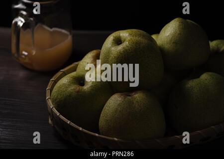 Food dark mood pear - Stock Image