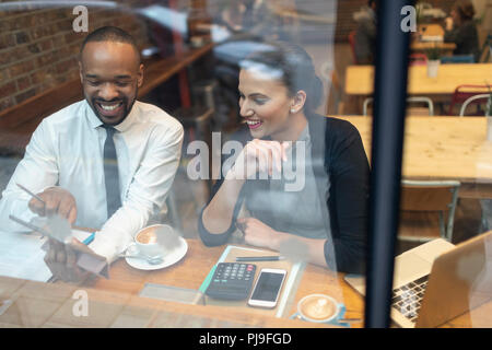 Business people working at cafe window - Stock Image