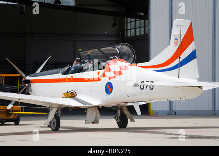 Croatian Air Force Pilatus PC9 trainer aircraft being towed into hangar, Zemunik AFB, May 17, 2008 - Stock Image