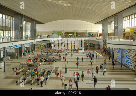 The inside of the main hall of Johannesburg train station, with people waiting their next transport, as seen from the second floor deck. Johannesburg, - Stock Image