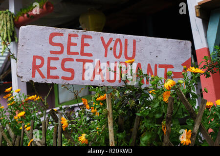 Hand painted wooden sign for See You Restaurant in Pothana, Annapurna Conservation Area, Nepal. - Stock Image