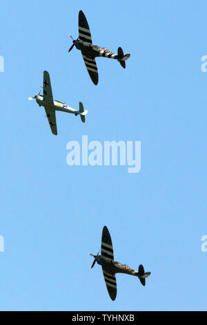 D-Day, D,Day, World War,two,2,fighter,planes,spitfire,Messerschmitt, ME 109, flying,information,over,Isle of Wight,England,UK, - Stock Image