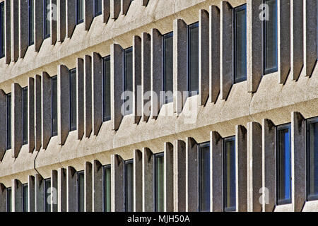 Geometric patterns formed by the concrete mullions and windows of an office block on Scarborough's Valley Bridge Road. - Stock Image