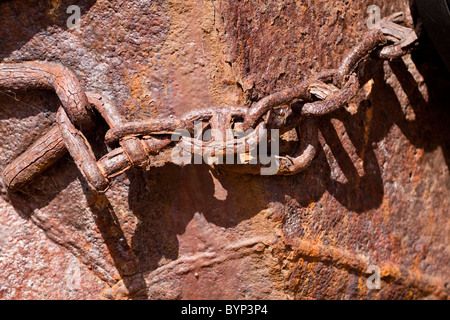 Rusted Chain on old boat - Stock Image