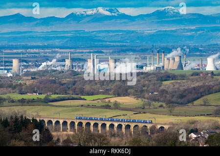 Railway viaduct and INEOS Grangemouth petrochemical plant and oil refinery in Scotland, UK - Stock Image