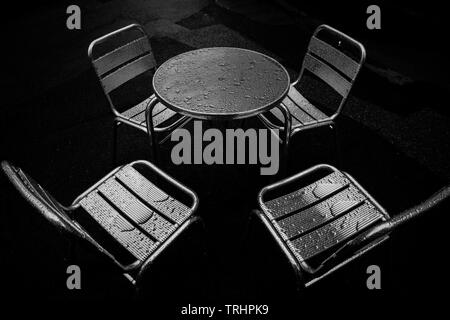 Wet cafe. Table and chairs - Stock Image