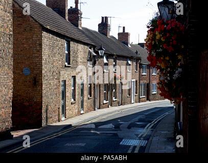 Terraced houses on Emgate, Bedale, Hambleton, North Yorkshire, England UK - Stock Image