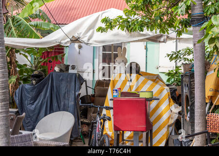 A yard in Gustavia, St Barts that is full of junk - Stock Image