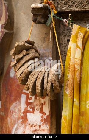 Discs of camel dung hanging in a doorway. Mandawa, Shekawati region, Rajasthan India - Stock Image