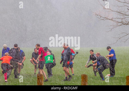 Northampton, UK. 8th March 2019. After a sunny start to the day, heavy rain came in midmorning soaking the people doing their keep fit classes in Abington Park. Credit: Keith J Smith./Alamy Live News - Stock Image