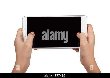 Closeup of a child's pair of hand holding a large screen smartphone isolated on white background - Stock Image
