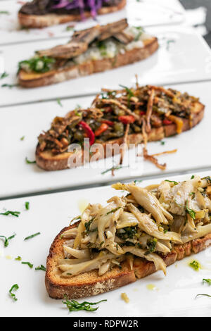 portuguese traditional tiborna toasted open sandwich tapas snacks on table - Stock Image