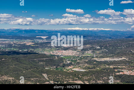 View from Montserrat to the town of Sant Vicenç de Castellet and the snow-capped Pyrenees mountains. Catalonia, - Stock Image