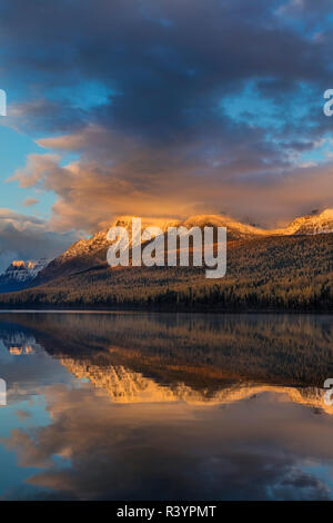 Mountain peaks reflect into Bowman Lake in autumn in Glacier National Park, Montana, USA - Stock Image