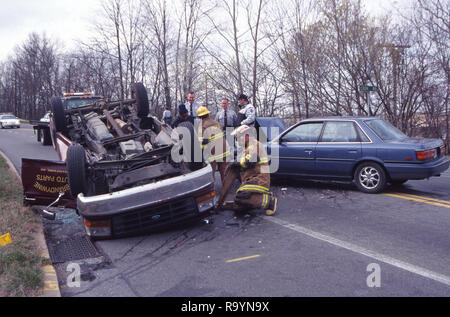 Auto accident with a truck flipped over - Stock Image