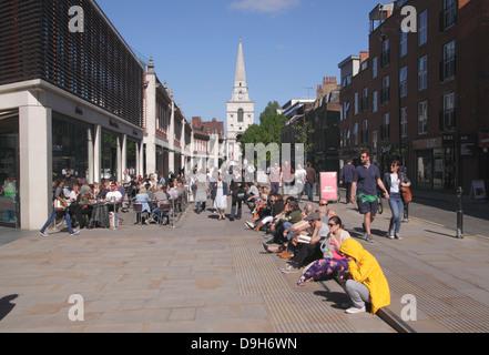 People enjoying the summer sunshine Spitalfields London - Stock Image