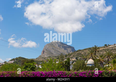 Xabia Spain view from town to the mountain including beautiful bougainvillea flowers in summer - Stock Image