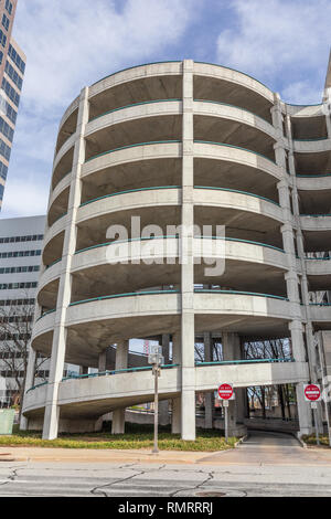 GREENSBORO, NC, USA-2/14/19: A stack of 7 circular ramps on a downtown parking garage. - Stock Image