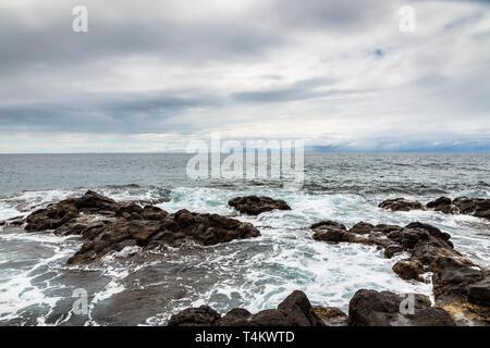 West coast rocky shoreline at Playa San Juan, Tenerife, Canary Islands, Spain - Stock Image