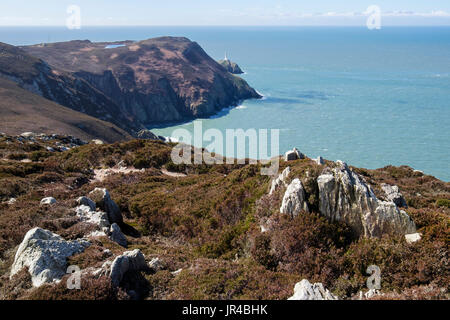 View to steep cliffs and South Stack (Ynys Lawd) across Gogarth Bay in European Geopark. Holyhead, Holy Island, Isle of Anglesey (Ynys Mon), Wales, UK - Stock Image