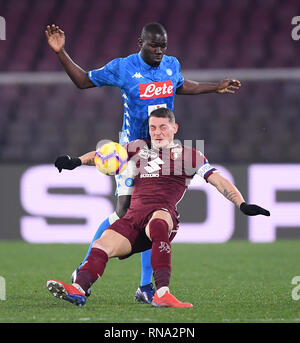 Napoli, Italy. 17th Feb, 2019. Napoli's Kalidou Koulibaly (top) vies with Torino's Andrea Belotti during a Serie A soccer match between Napoli and Torino in Napoli, Italy, Feb. 17, 2019. The match ended with a draw 0-0. Credit: Alberto Lingria/Xinhua/Alamy Live News - Stock Image