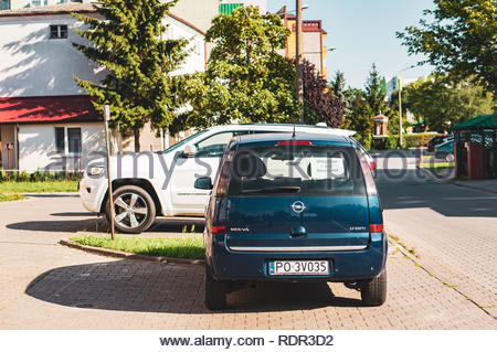 Poznan, Poland - July 20, 2018: Parked new Opel car by apartment blocks on the Stare Zegrze district - Stock Image