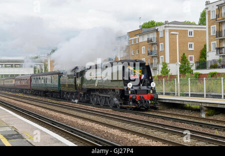 Bullied Pacific Battle of Britain Class Locomotive with Golden Arrow at Kensington Olympia -2 - Stock Image