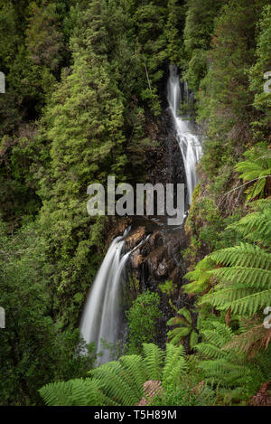 Double drop waterfall in a lush rainforest - Stock Image