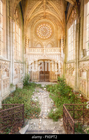 Interior view of an abandoned Gothic chapel in France. - Stock Image