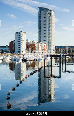 Contemporary housing including the Tower at Meridian Quay, Swansea Marina, in the old harbour. - Stock Image
