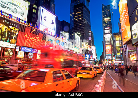 TIMES SQUARE, NEW YORK CITY, NYC, MANHATTAN, ADVERTISEMENT, AUTOMOBILE, BLUE, BROADWAY, BUSINESS, COMMERCE, BUSY, - Stock Image