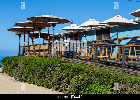 umbrellas on the wood deck of  Beachcomber Restaurant at Crystal Cove State Park California USA - Stock Image