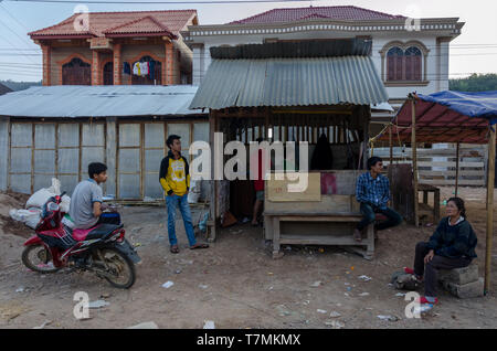 People outside a barber in Muang Khua, Laos - Stock Image