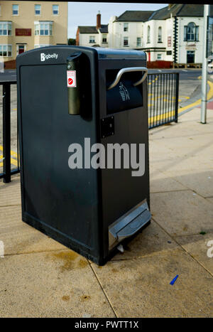 A Big Belly Smart Waste bin, with built in capability to measure and transmit by radio whether it is full or empty so that emptying can be timed - Stock Image