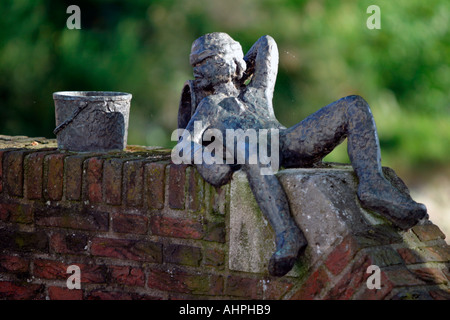 Statue taking it easy, lazy in the sun, Schoonhoven, Southern Holland, The Netherlands - Stock Image