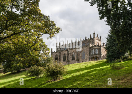 Auckland Castle (the Bishop's Palace), County Durham, UK. Chapel of St Peter (built 1190, converted to chapel 1661), seen from the 12c deer park - Stock Image